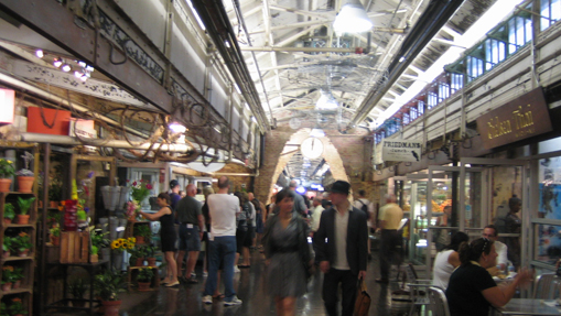 Chelsea Market, NYC. The way in which activities spill out onto the corridor and the high ceiling make it seem like an outdoor space. Photo: LShieh